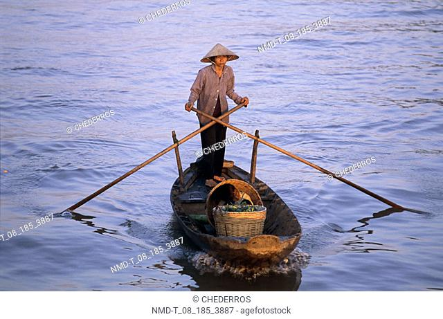 High angle view of a man standing on a boat, Vietnam