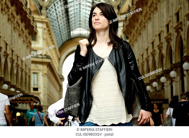 Woman shopping in Galleria Vittorio Emanuele II, Milan, Italy