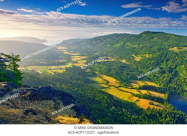 View of farmland from summit of Mount Maxwell, Mount Maxwell Park, Saltspring Island, Gulf Island, British Columbia, Canada