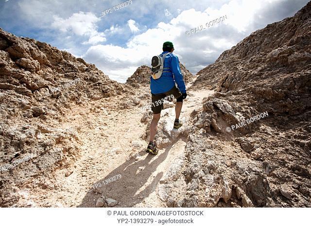 Runner hiking along the White Mesa Bike Trails Area - Ojito Wilderness - New Mexico