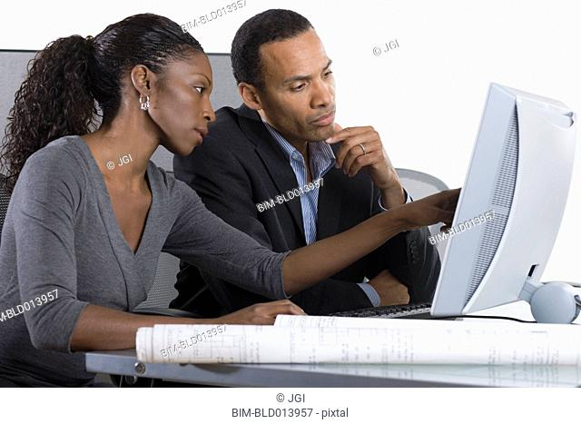 Partners working on computer together in office