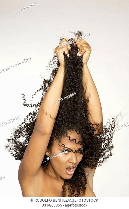 Black Latin girl pulls her sexy wavy hair