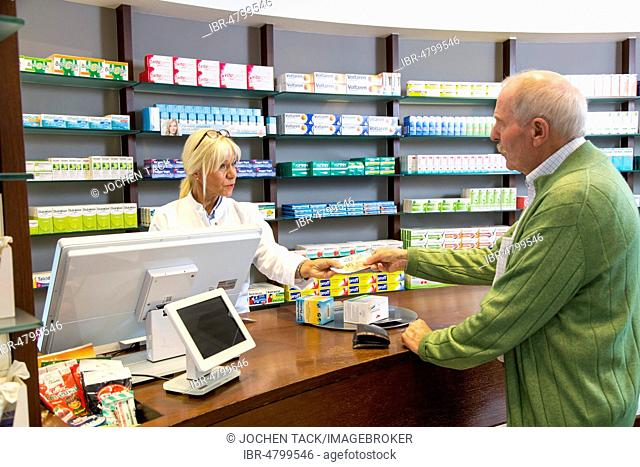 Pharmacy, Pharmacist advises a customer picking up a medicine on prescription, Germany