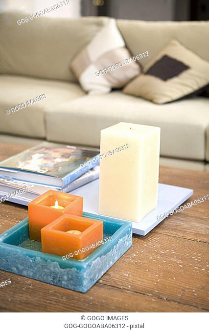 Lit candles on coffee table