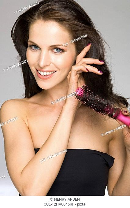 female beauty brushing hair