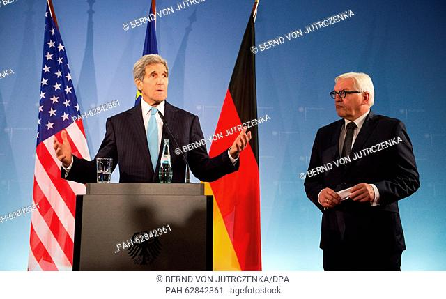 USSecretary of State John Kerry (L)and German foreign minister Frank-Walter Steinmeier deliver remarks on the Middle East conflict during a joint press...