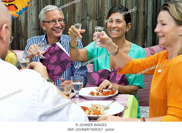 People drinking at crayfish party, Sweden
