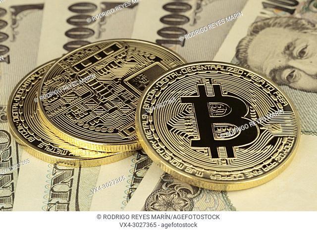 Virtual currency Golden Bitcoins on 10, 000 Japanese Yen bills. (Photo by Rodrigo Reyes Marin)