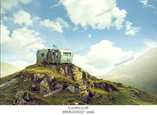 Motor home on hill in green landscape