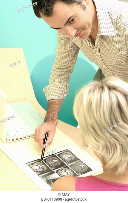 WOMAN CONSULTING FOR BACK PB. Models. Lumbar scanner