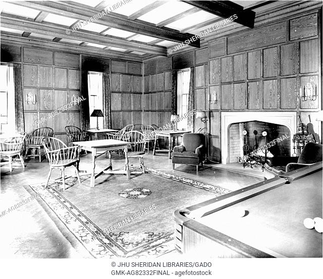 Interior of the billiard room in the Johns Hopkins Club, containing tables and chairs, a fireplace, and a pool table, in Baltimore, Maryland, 1900