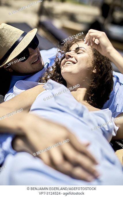 happy woman enjoying life next to lover, love, flirt, couple, vacations, summer