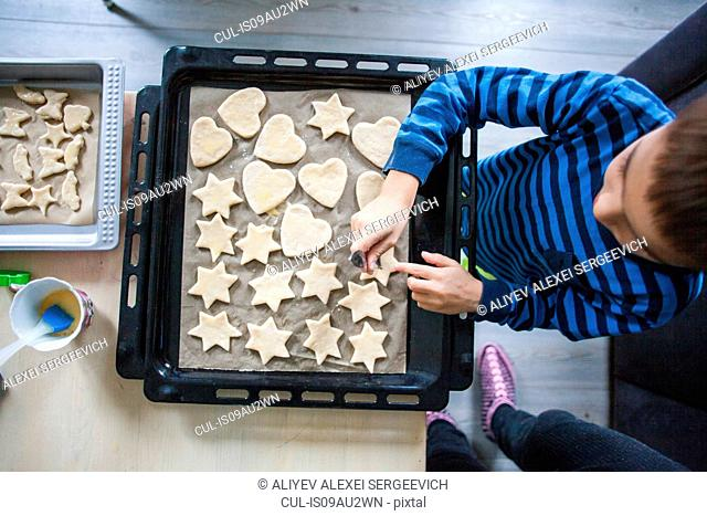 Young boy making cookies, overhead view