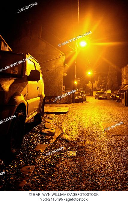Parked cars on empty street at night in clwt y bont wales great britain uk
