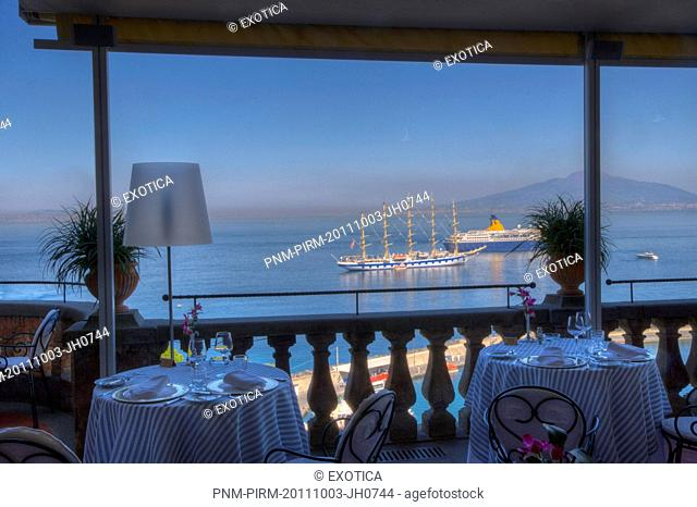 Empty tables and chairs at a restaurant on the terrace of a hotel, Sorrento, Campania, Italy