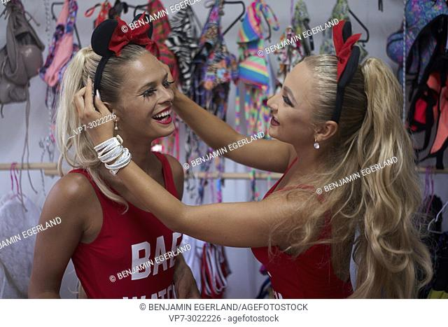 two dancer girls in fitting room, dressing and getting ready for the show. Wearing bunny head costume