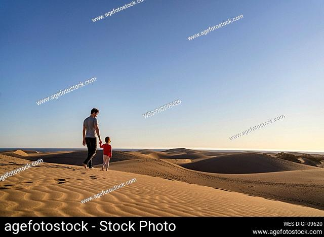 Father and daughter in sand dunes, Gran Canaria, Spain