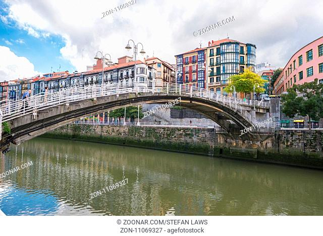 Bridge across the Nervion river in the San Frantzisko district of Bilbao. The area has a multi cultural neighborhood and is exciting part of the city