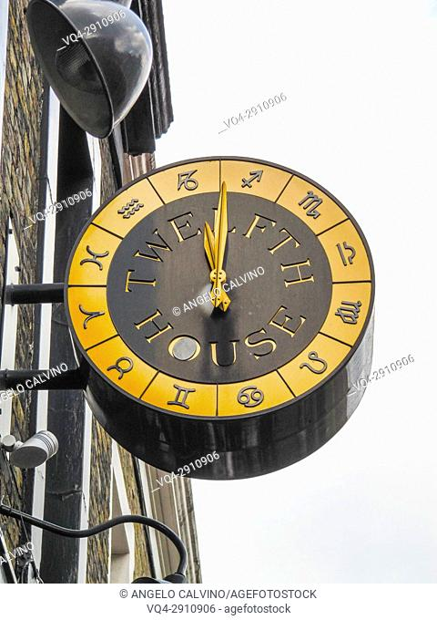The external sign and clock of Twelfth House Pub, London, UK