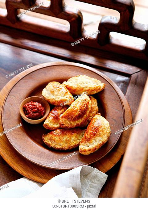 Plate of curry puff with dipping sauce