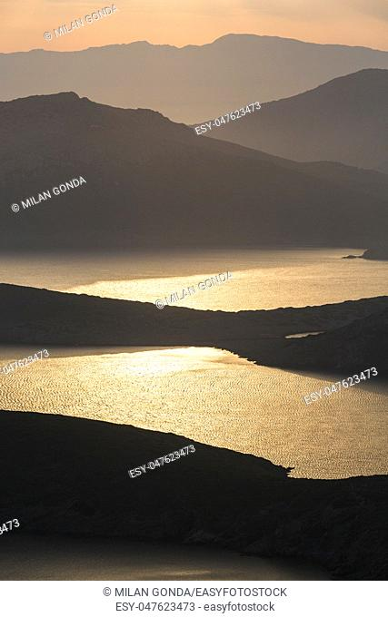 View of Fourni, Kisiria, Thymaina and Ikaria islands silhouetting against evening sky and sea.