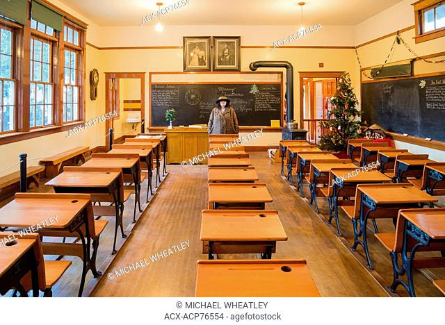 Heritage School room with teacher, Burnaby Village Museum, Burnaby, British Columbia, Canada