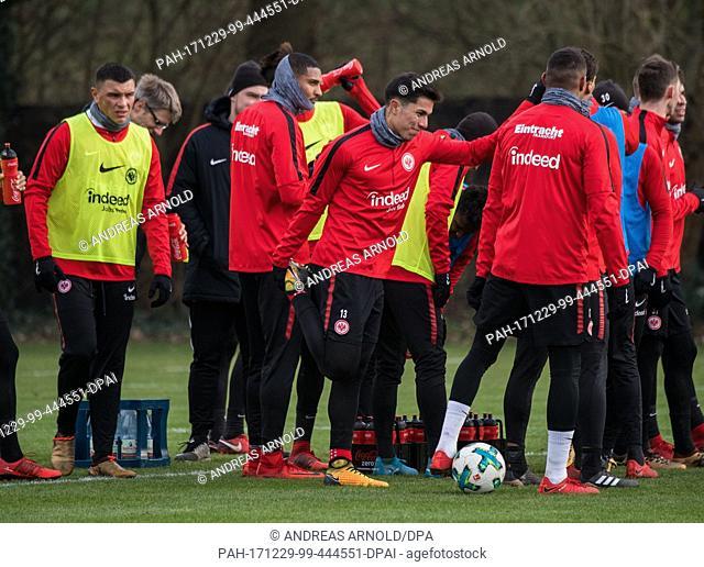 Frankfurt's Carlos Salcedo (C) stretches during the first training session of the German Bundesliga soccer club Eintracht Frankfurt in Frankfurt am Main