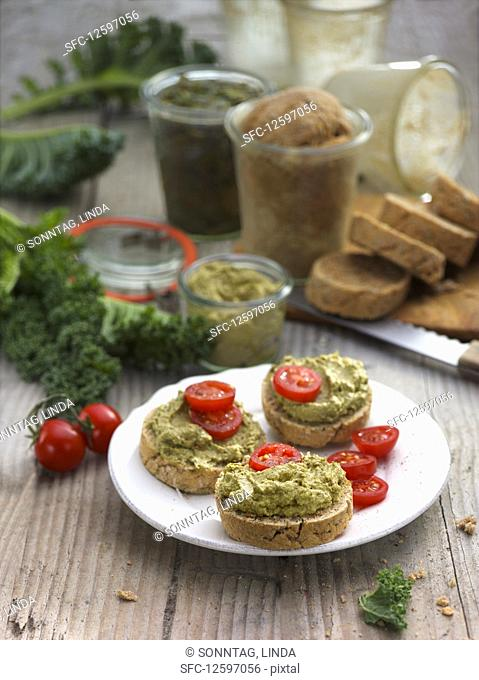 Kale cream and cherry tomatoes on country bread