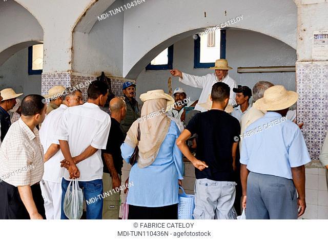 Tunisia - Jerba - Hount-Souk - Hawker selling on the fish market