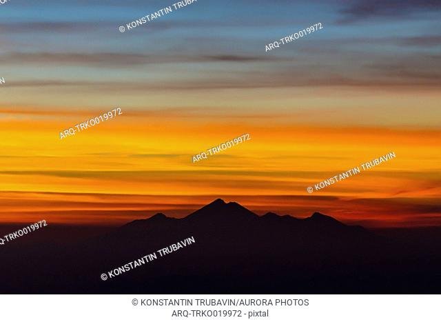 Beautiful landscape with silhouette of Rinjani mountain at sunset, Lombok, Bali, Indonesia