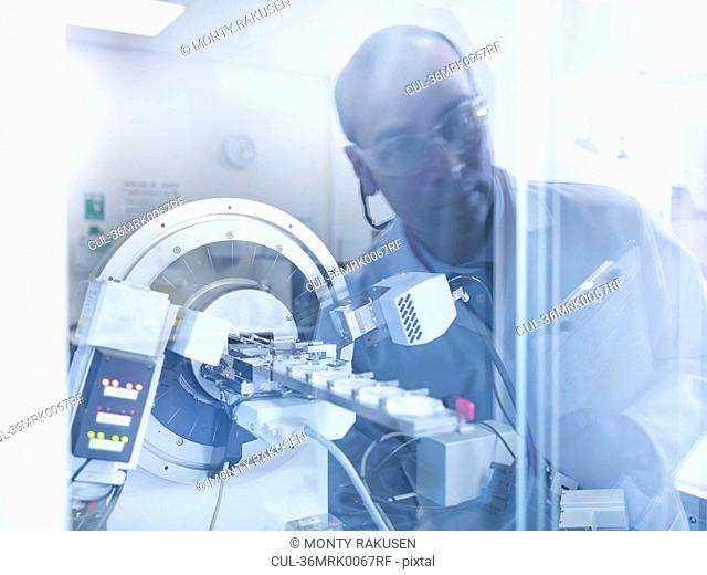 Scientist working with equipment in lab