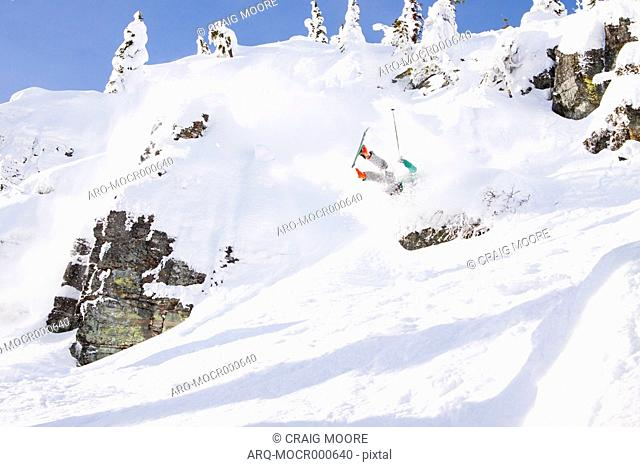 A Male Skier Crashes After Catching An Edge On A Rock At Whitefish Mountain Resort