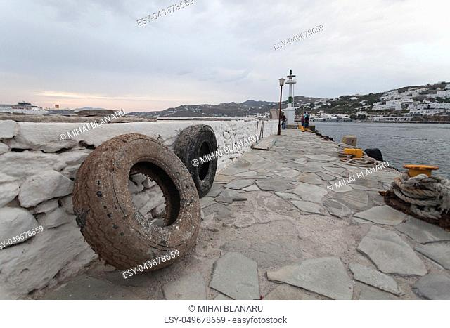 Detail of an old tire used as a boat stopper in Mykonos, a famous place in Cyclade islands