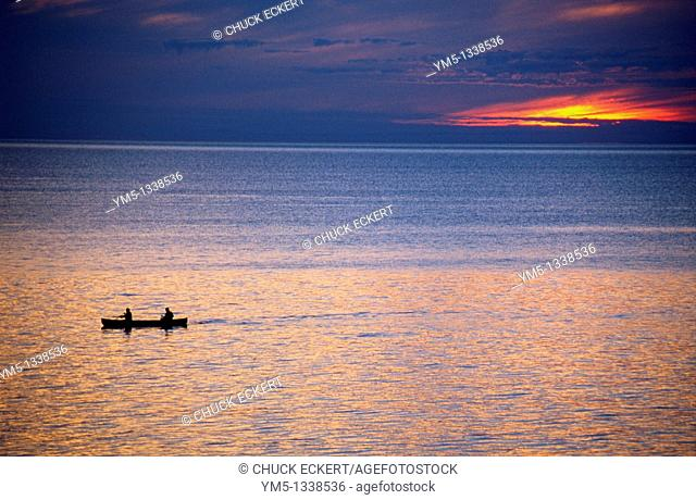 Two men canoeing on Lake Superior at sunset