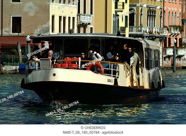 Tourists in a tourboat, Grand Canal, Venice, Veneto, Italy