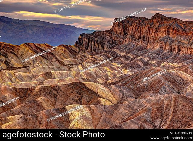 A picturesque colorful desert-Scene with heavily eroded Ridges taken at the well-known Zabriskie Point, Death Valley National Park, California, USA