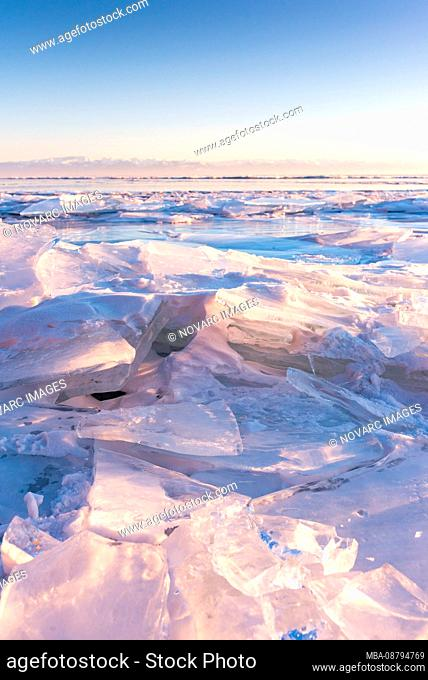 Ice pieces and ice sculptures at sunset on Lake Baikal, Siberia, Russia