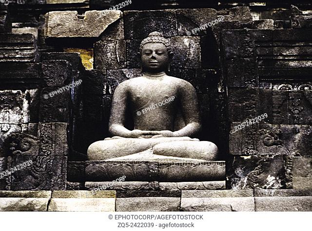 Buddha in west niche. Borobudur. The walls are marked with scenes that depict Prince Siddharta's transformation to Gautama Buddha