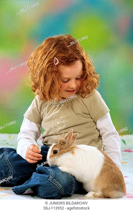 girl with pygmy rabbit on her lap