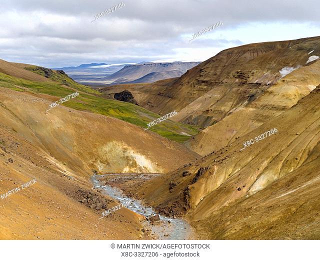 Landscape in the geothermal area Hveradalir in the mountains Kerlingarfjoell in the highlands of Iceland. Hofsjoekull in background