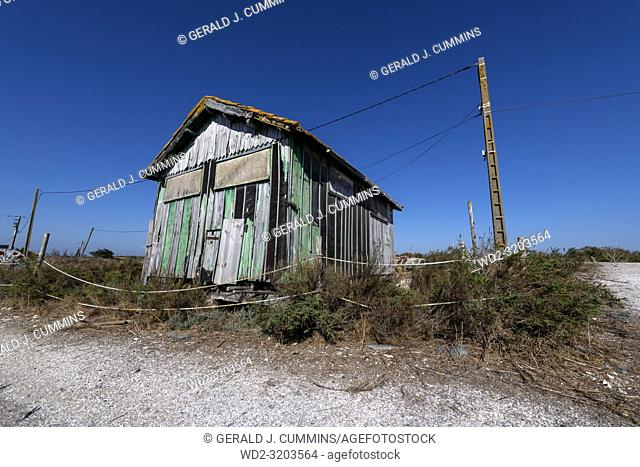 Europe, France, Island of Oléron, 2018, Old oyster farming sheds, cabins. Ruins sometimes turned into touristic workshops