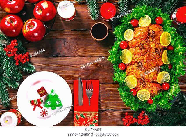 Christmas table dinner time with roasted meats decorated in Christmas style. Background thanksgiving. The concept of a family holiday, Beautiful delicious food