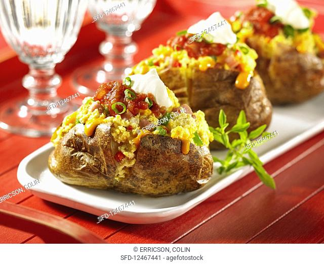 Twice baked potatoes stuffed with egg cheese and salsa