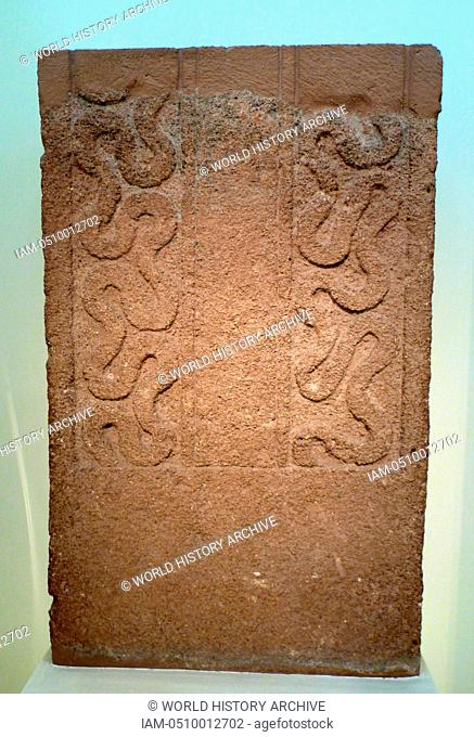 Funerary Stele made from porous stone with a chariot scene in relief. Mycenae Grave Stele from Grave circle A Grave V, 16th century BC, Greece