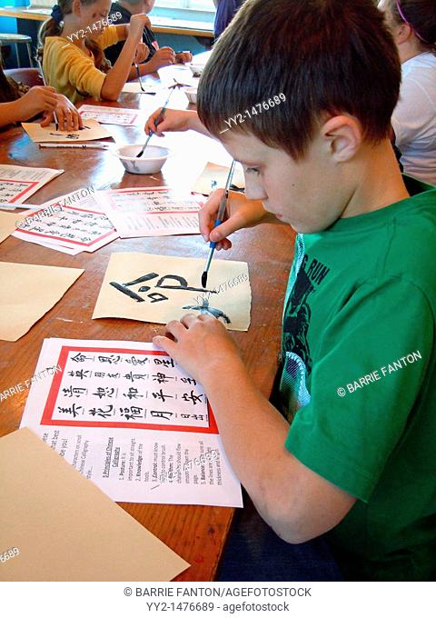 6th grade boy, art class, calligraphy