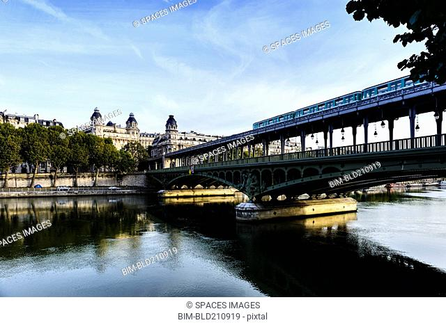 Paris city skyline reflected in river, Paris, France