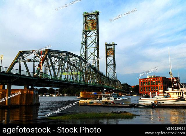 The Portsmouth Memorial Bridge spans the Piscataqua River, connecting the New Hampshire town to Kittery, Maine