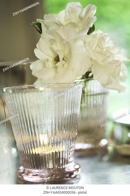 Candleholder and flower blossoms