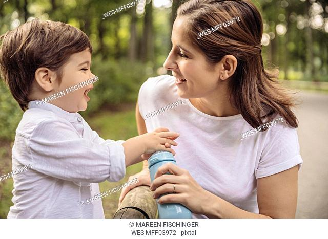 Mother and her little son having fun together in a park