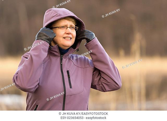 Outdoor woman put hood over her head
